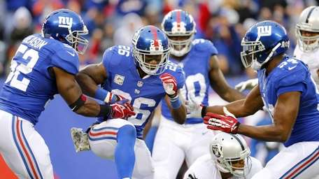Antrel Rolle celebrates a sack of Oakland Raiders