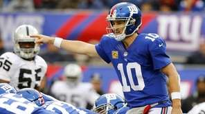 Giants quarterback Eli Manning (no. 10) directs his