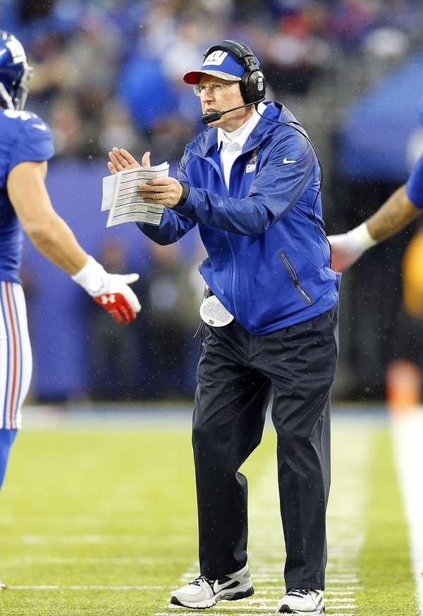 Tom Coughlin applauds his team after a touchdown