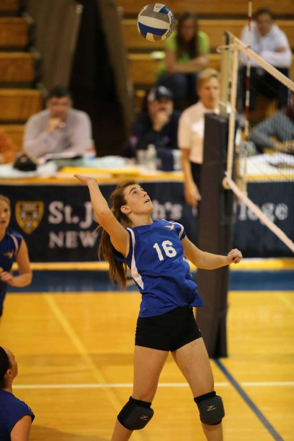 Mattituck middle hitter Shannon Dwyer goes up for