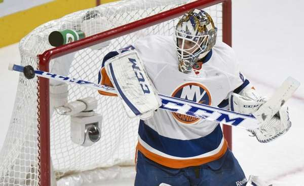 Islanders goalie Kevin Poulin deflects a shot during