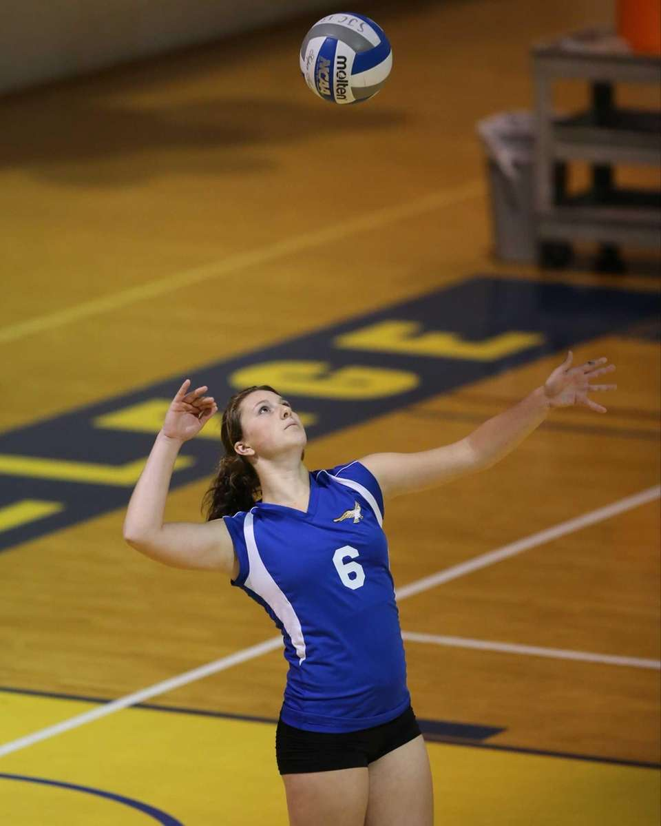Mattituck's Emilie Reimer serves to Carle Place during