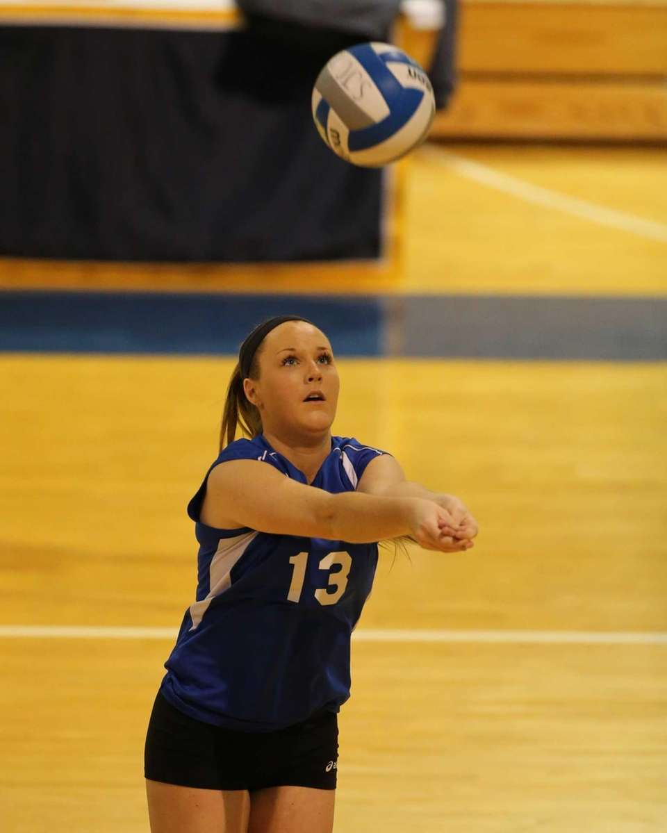Mattituck setter Laurel Bertolas passes against Carle Place
