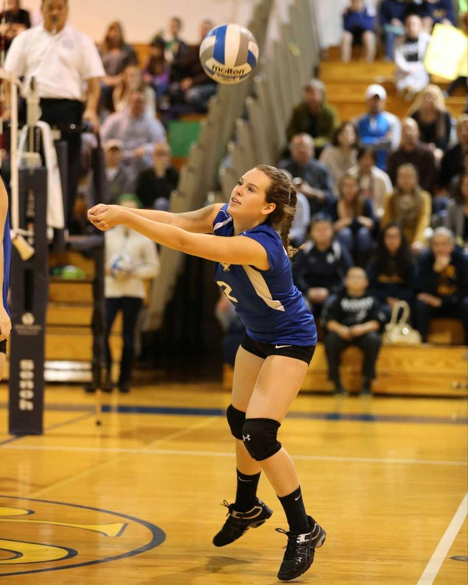 Mattituck's Lizzie Wilcenski passes against Carle Place during