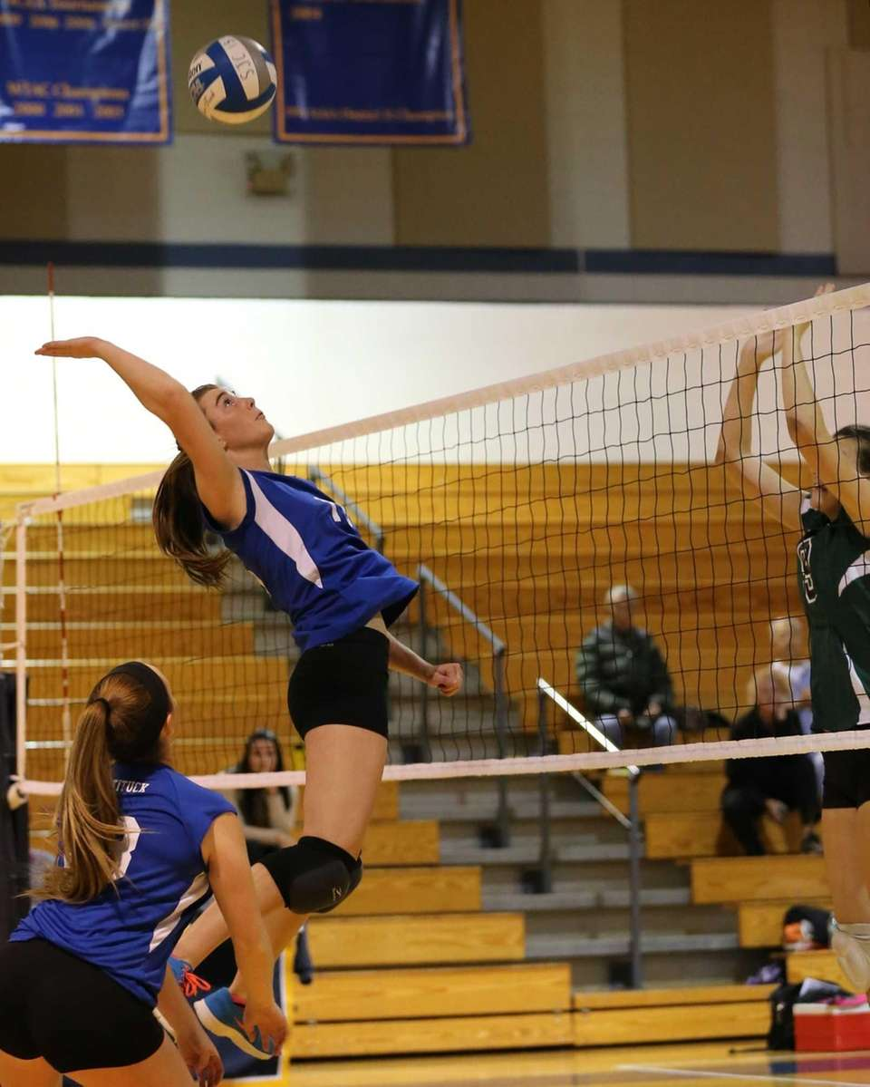 Mattituck middle hitter Shannon Dwyer (no. 16) goes