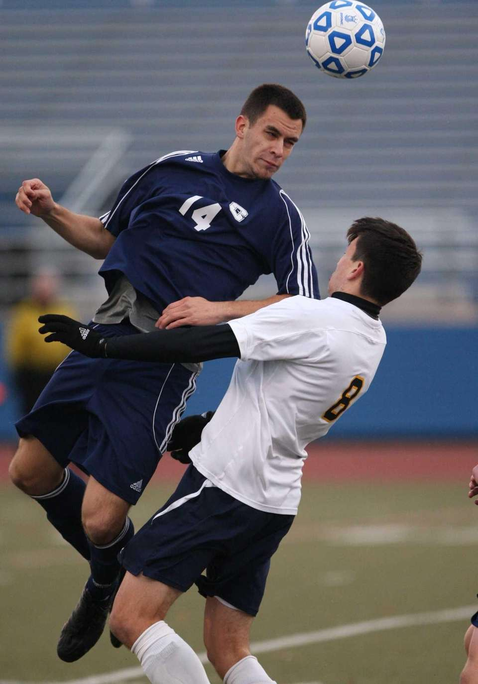 Smithtown West's Matthew Aprile goes for the ball