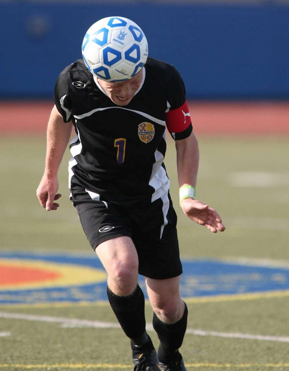 Andrews Spencer of Sayville heads the ball during