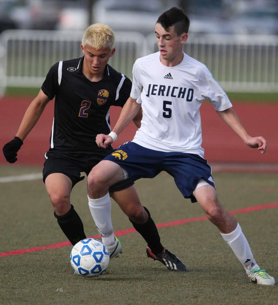 Jericho's Andrew Greenblatt tries to take the ball