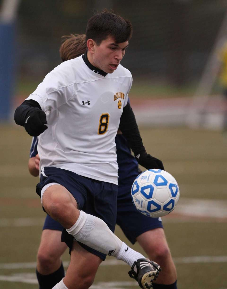 Massapequa's Brendan Gallivan plays the ball during the