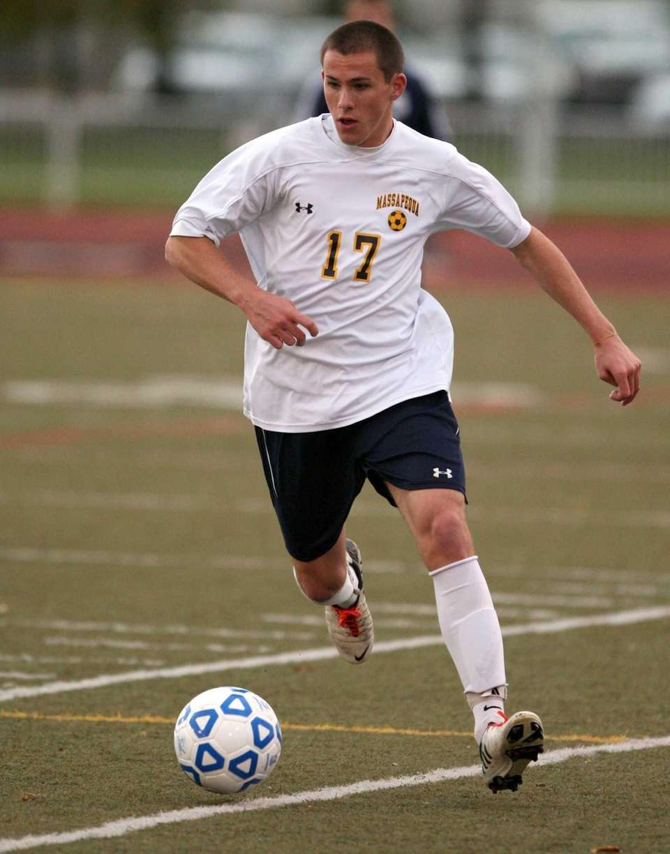 Nick Bernhard of Massapequa moves the ball during