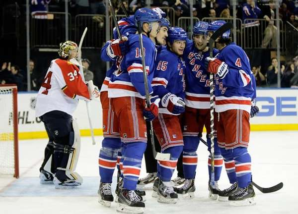 Derek Dorsett celebrates with teammates after he scored