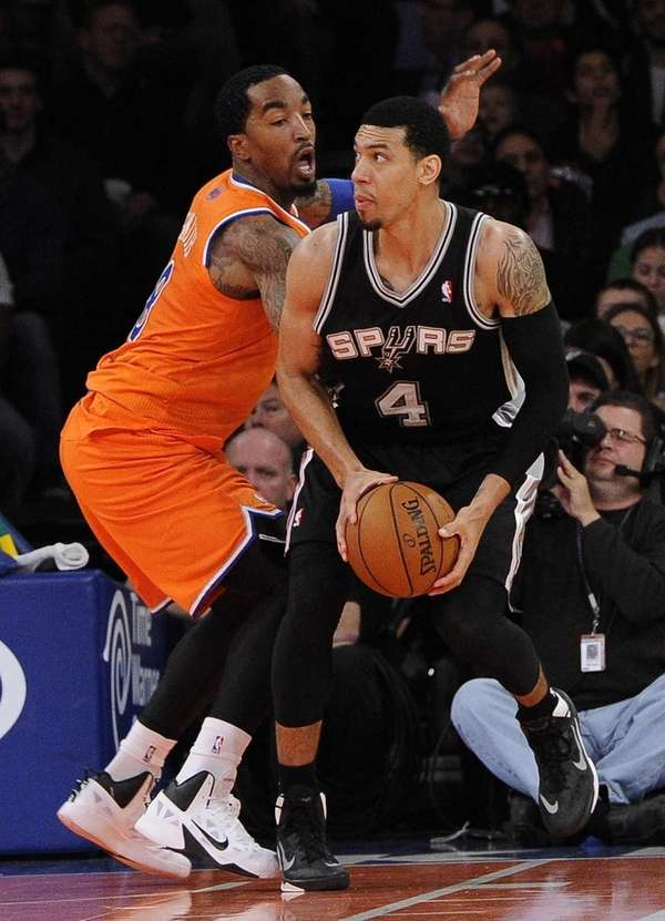 Knicks guard J.R. Smith defends against San Antonio