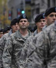 U.S. soldiers march along fifth avenue as part