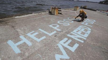 A survivor writes a message on their port