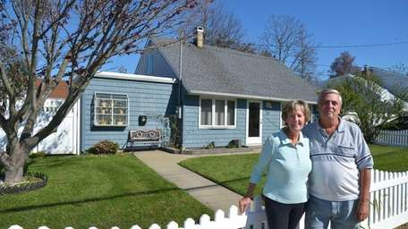 Kathy and Joe Missilli outside their home on