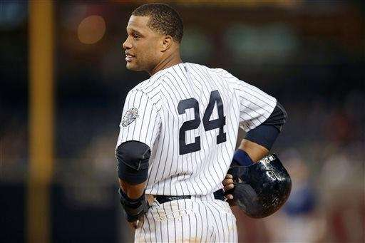 Robinson Cano looks toward the dugout during the