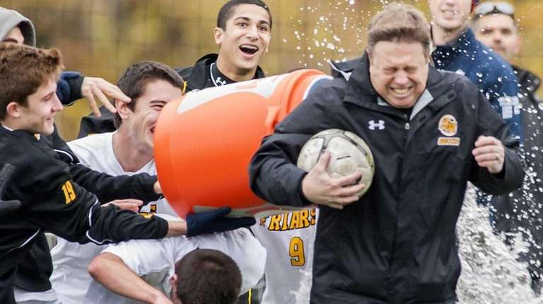 St. Anthony's assistant coach Don Corrao, right, gets