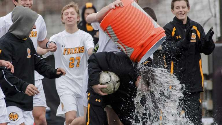 St. Anthony's assistant coach Don Corrao gets water
