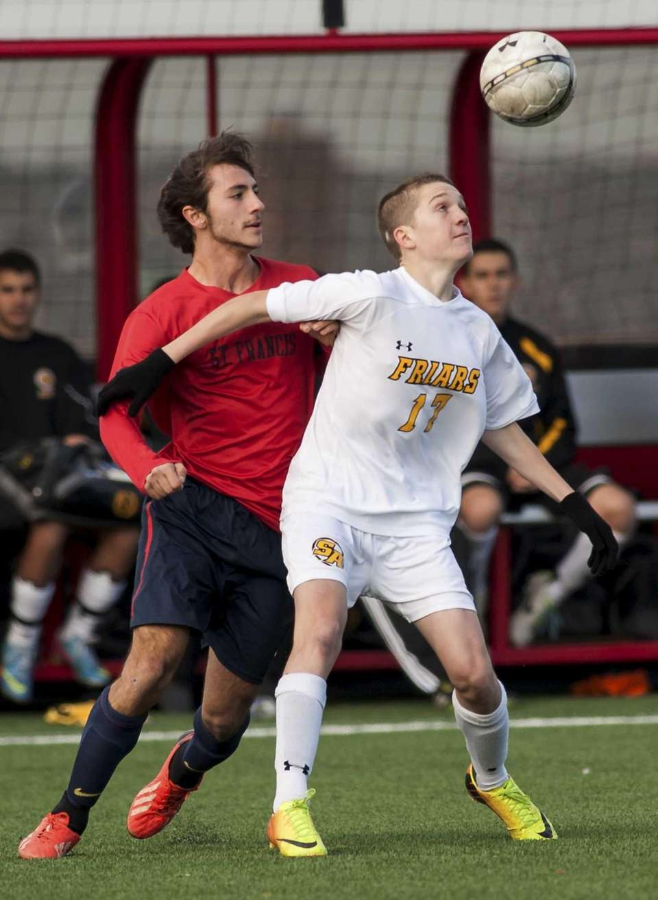 St. Anthony's John Foley, right, fights for the