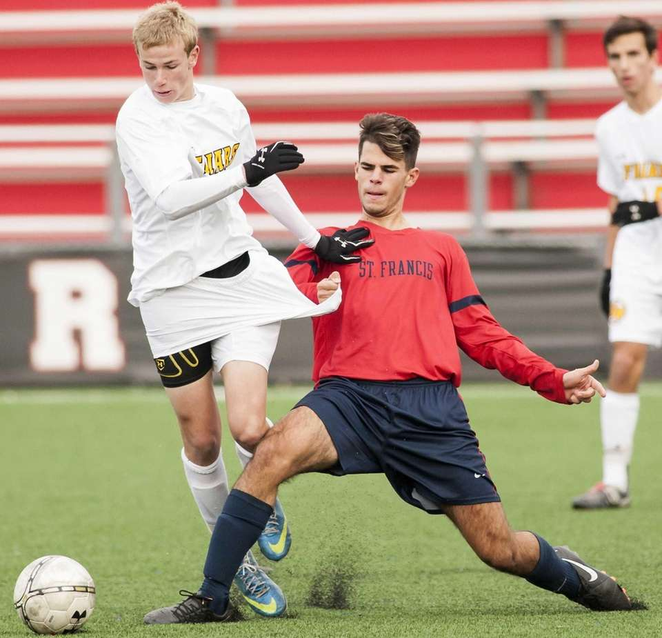 St. Anthony's Justin Carfora, left, fights for the