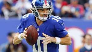Eli Manning looks to throw a pass during