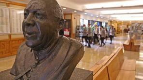 A statue of Bishop Kellenberg is in the
