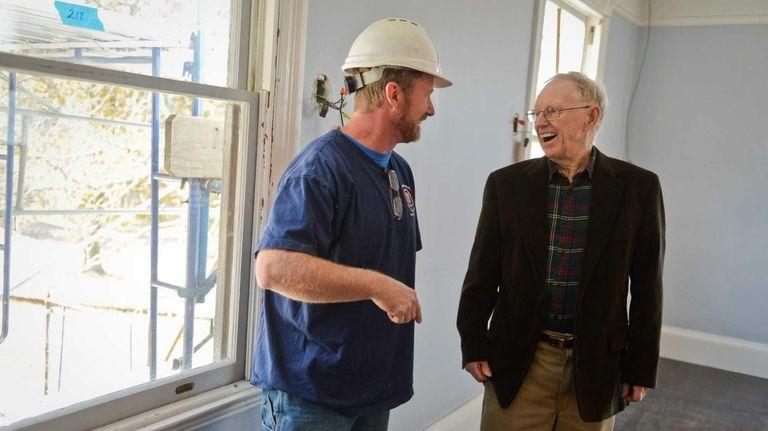 Richie Vischof, left, a carpenter with E +