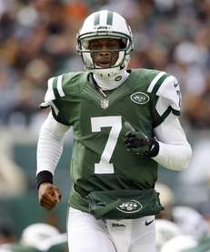 Geno Smith looks on during a game against