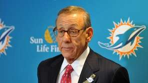 Miami Dolphins owner Stephen Ross talks to the