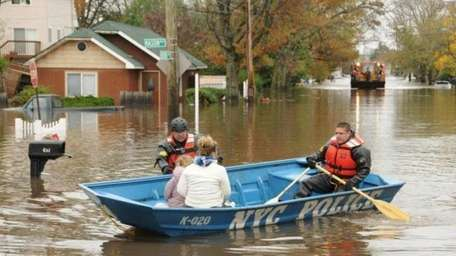 Residents evacuate Mason Ave. on Staten Island after