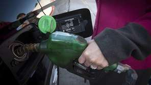 Huntington resident Stacy Brown buys diesel fuel for