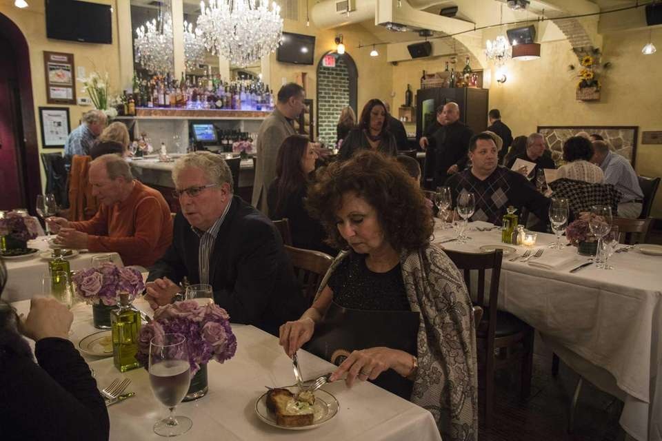 Diners enjoy the rustic ambience at J. Michaels