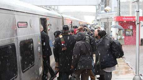Commuters dodge snowflakes at the Mineola LIRR station