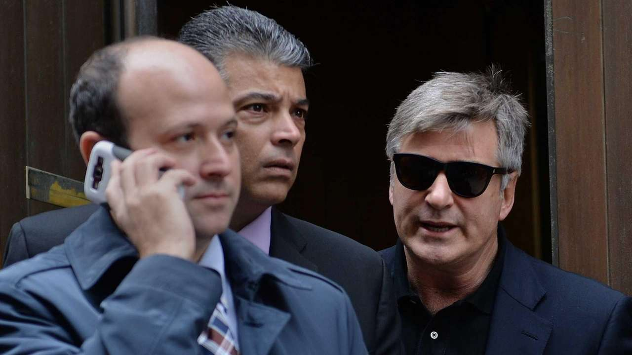 Alec Baldwin, right, leaves Manhattan Criminal Court after