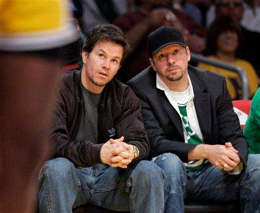 Mark Wahlberg, left, sits with his brother Donnie