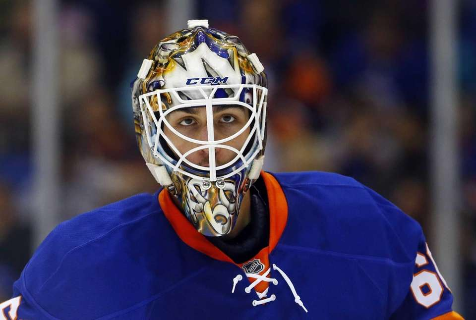 Kevin Poulin of the Islanders looks on in