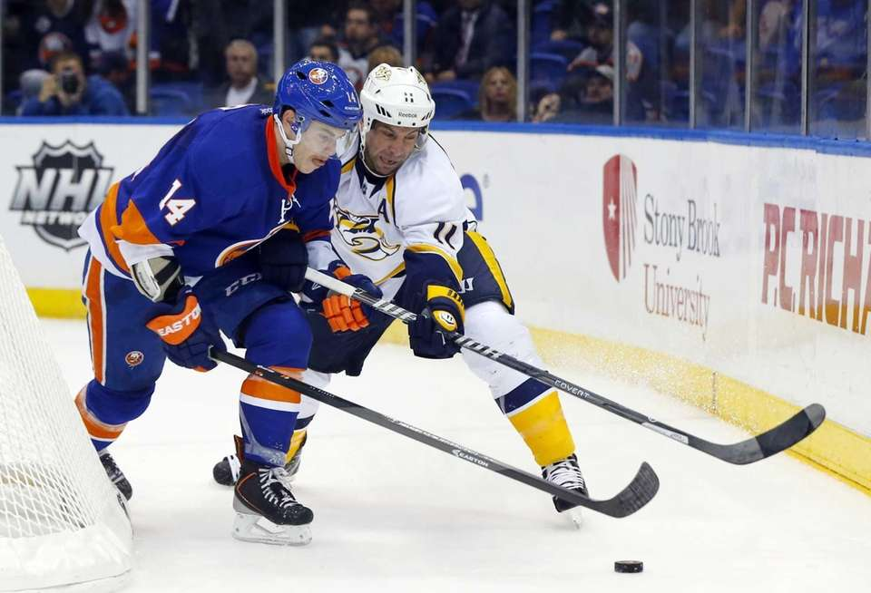 Thomas Hickey of the Islanders defends against Eric