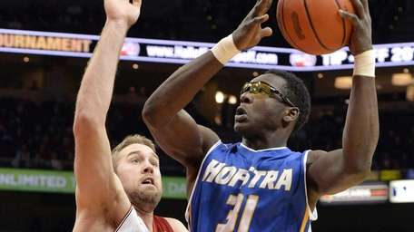 Hofstra's Moussa Kone, right, gets a shot off
