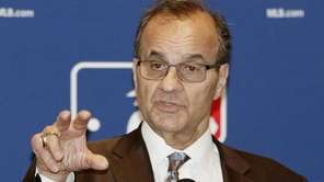 Major League Baseball executive Joe Torre talks with