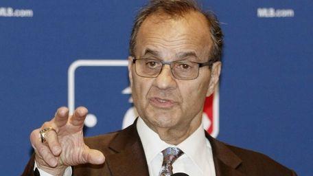 Major League Baseball executive Joe Torre talks with