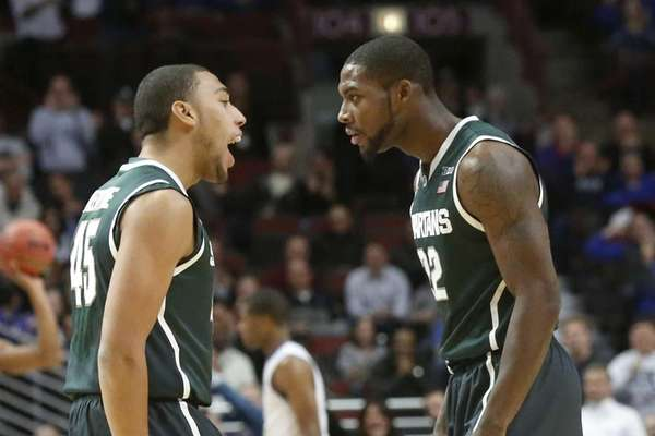 Michigan State guard Denzel Valentine talks to Branden