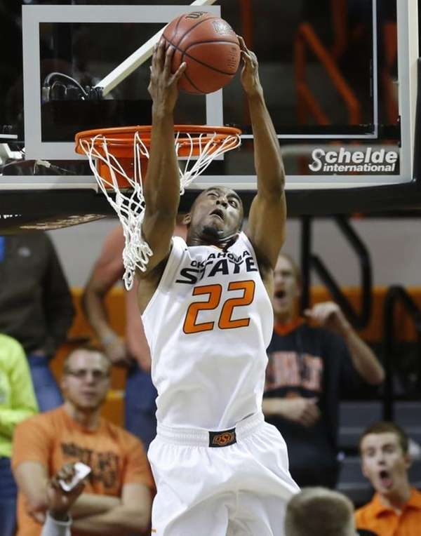 Oklahoma State's Markel Brown dunks against Utah Valley