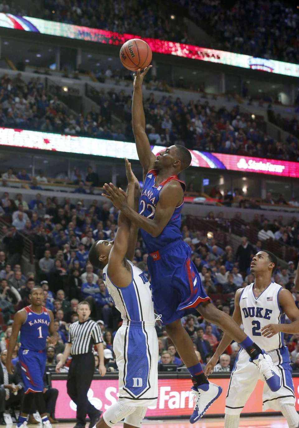 Kansas guard Andrew Wiggins, right, shoots over Duke
