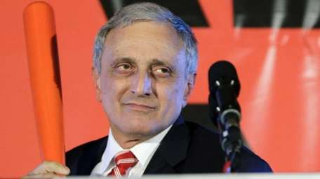 The 2010 Republican gubernatorial candidate Carl Paladino holds