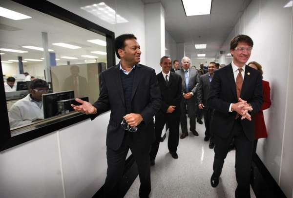 Amneal chief Chintu Patel, left, shows the company's