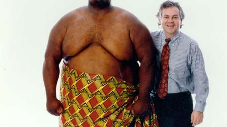 UFC co-creator Campbell McLaren, right, poses with 700-pound