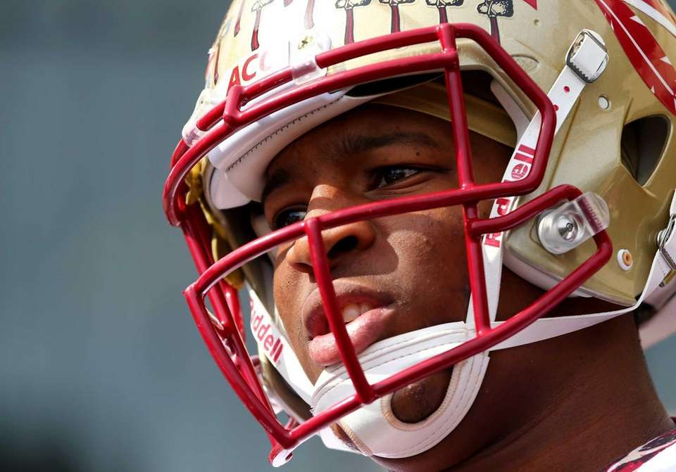 Florida State quarterback Jameis Winston looks on before