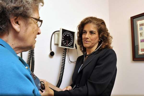 Dr. Louise Spadaro checks blood pressure during a
