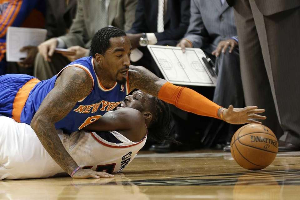 Knicks guard J.R. Smith dives over Atlanta Hawks