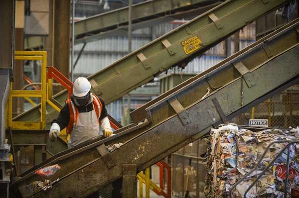 Employees sort recyclables on machines at Brookhaven Town's